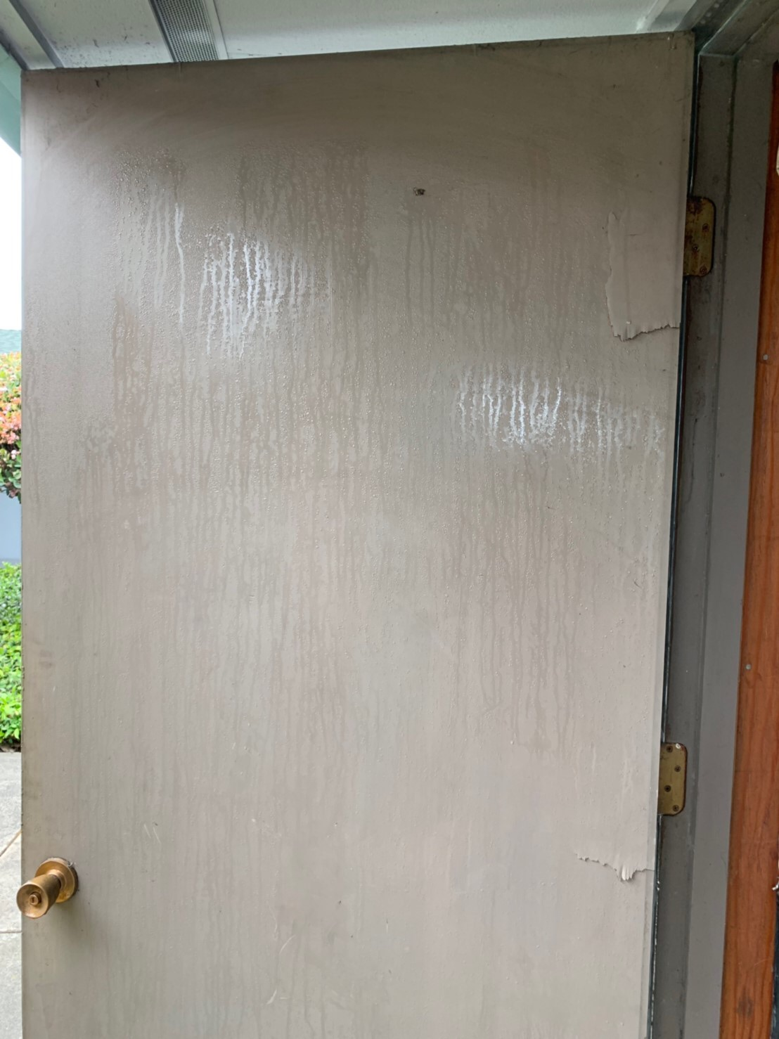 Pre-Renovation steamed door caused by pipe leakage in ICON Chiropractic Campbell Office