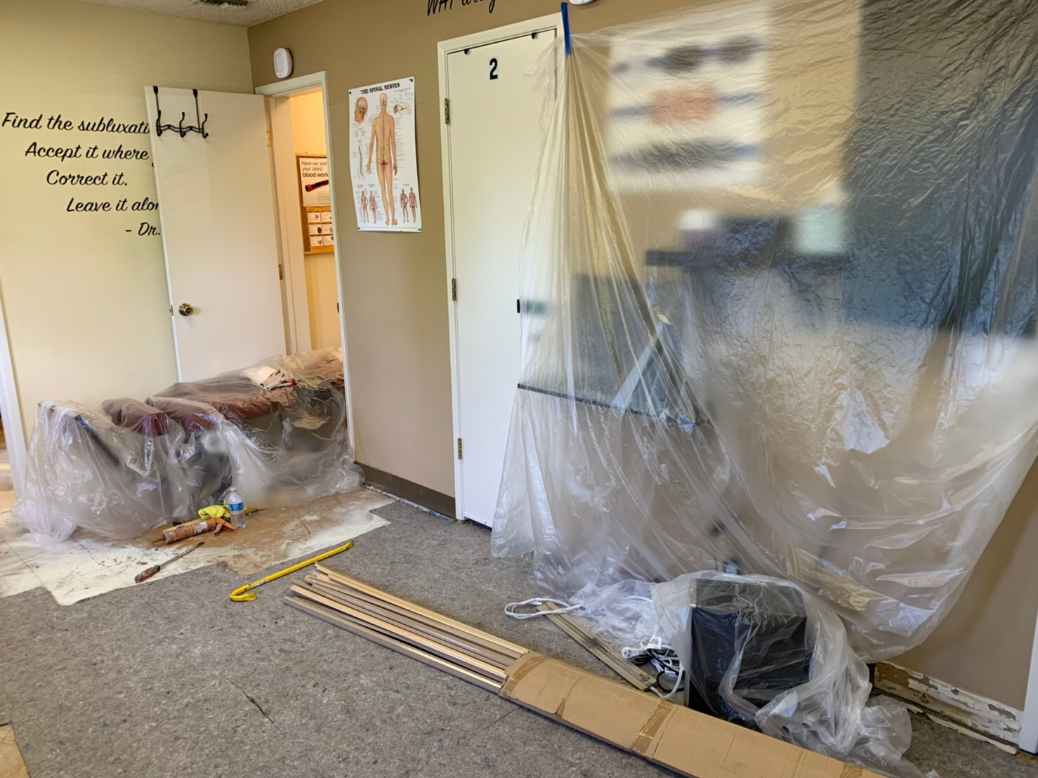 Renovation preparation, to put protections to prevent equipment damage in ICON Chiropractic Campbell Office